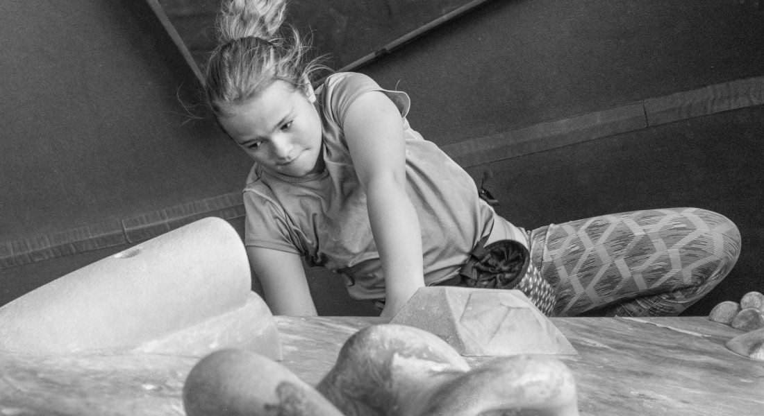 A Child Climbs in a Bouldering Gym B&W