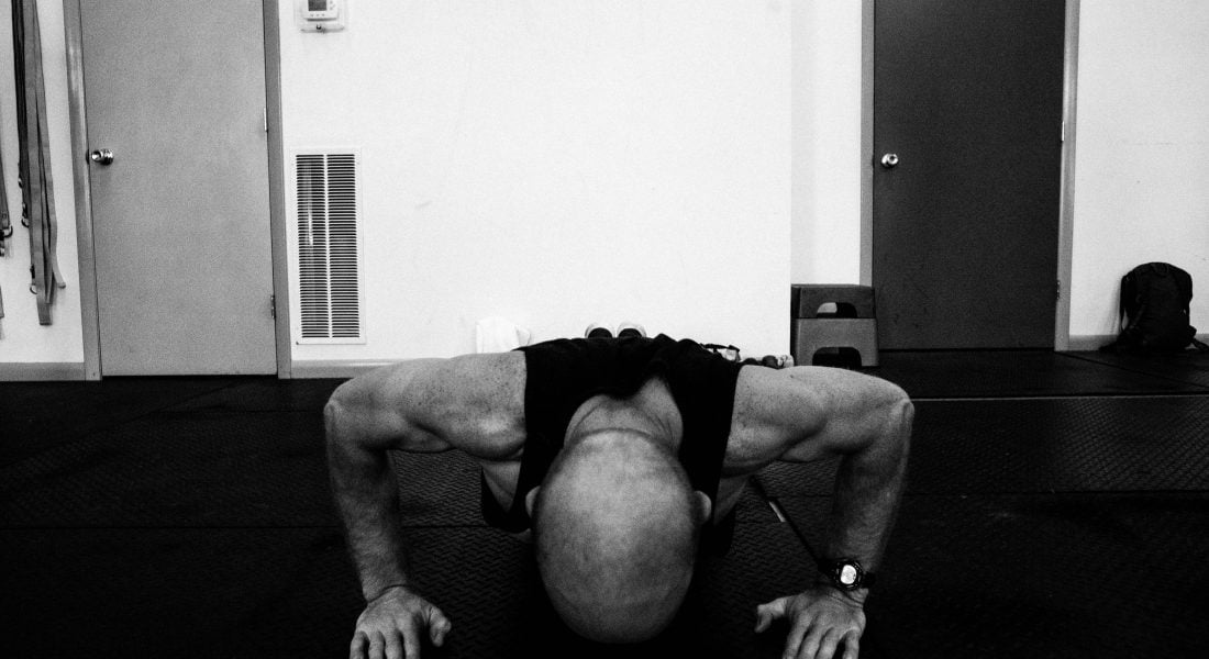 Jordan Jack Demonstrates a Push Up in Climb Strong Class B&W