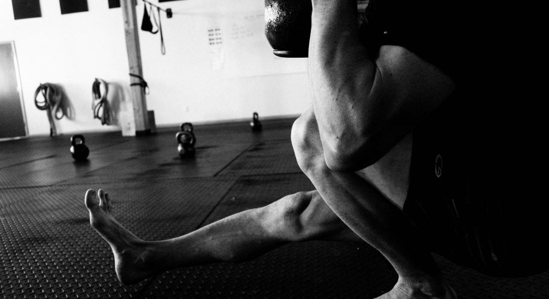 Charlie Manganiello Pistol Squat with Kettlebell B&W, Photo by Mei Ratz